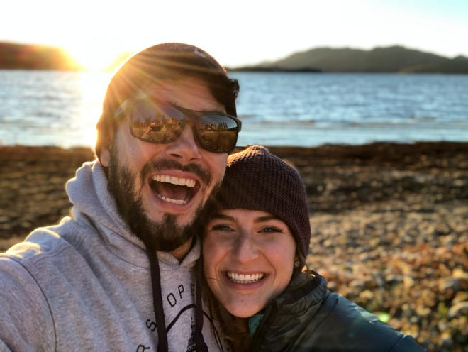 Alexander Lofgren, 32, a Tucson veteran and congressional aide who died in a hiking accident in Death Valley National Park in April 2021, poses with his girlfriend, Emily Henkel, 27, in California.