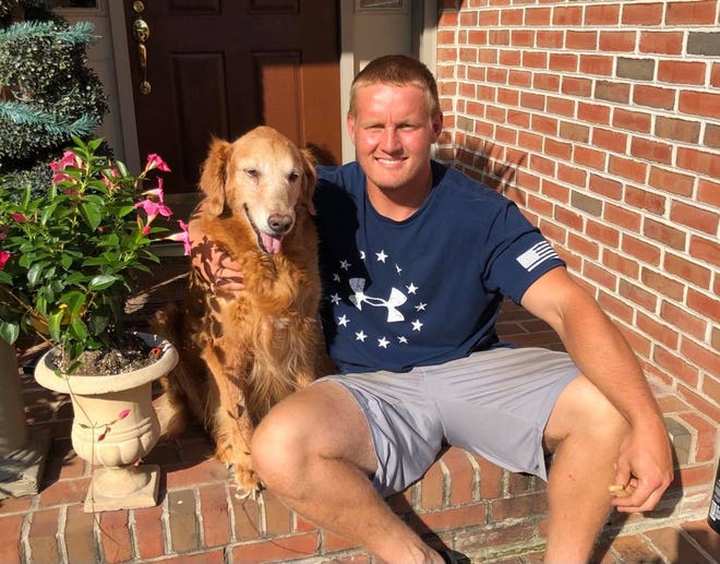 Former Elco football star Tyler Horst, with one of his favorite companions, dreamed of becoming a Navy SEAL before his death in a car crash in January at age 22.