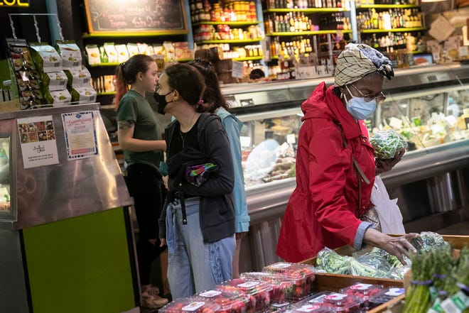 Beatrice Brown, 73, wears two masks while shopping for produce inside Reading Terminal Market in Philadelphia on June 11, 2021. (HEATHER KHALIFA/Philadelphia Inquirer/TNS)
