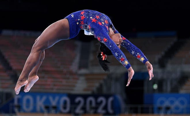 U.S. gymnast Simone Biles competes on the beam in the women's team qualifying at the 2020 Tokyo Olympics on Sunday, July 25, 2021. She withdrew days later, citing her mental health. (Wally Skalij/Los Angeles Times/TNS)