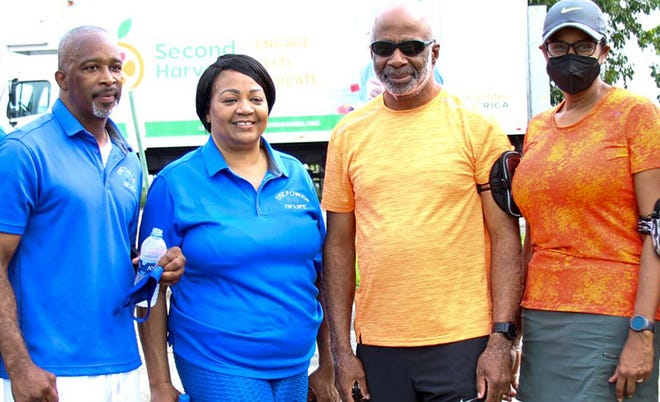 Left to right: Lane Harper, Teresa Berger, Larry Robinson, and Sharon Robinson at the Power of Life Foundation back-to-school giveaway on Saturday, July 24, 2021.