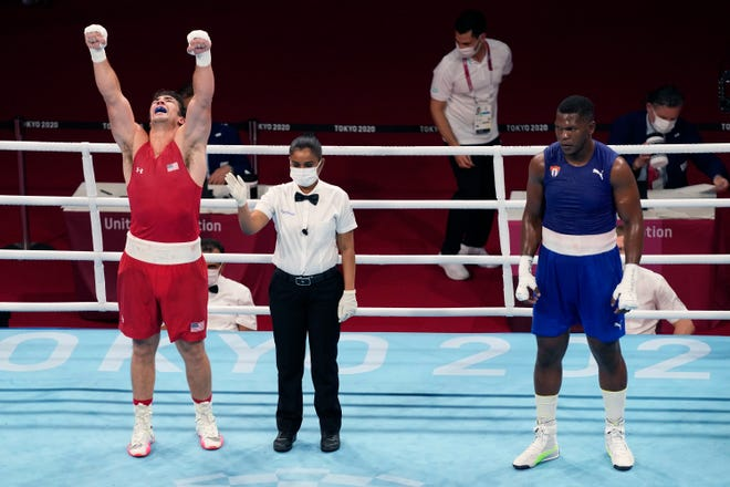 Richard Torrez Jr., from the United States, left, and Cuba's Dainier Pero after their men's super heavyweight over 91-kg boxing match at the 2020 Summer Olympics, Sunday, Aug. 1, 2021, in Tokyo, Japan. (AP Photo/Frank Franklin II)