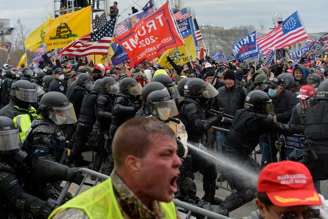 Trump supporters clash with police and security forces outside the U.S. Capitol on Jan. 6, 2021.