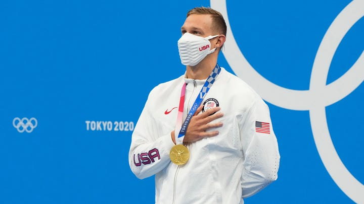 Caeleb Dressel with his gold medal after winning the men's 50-meter freestyle.