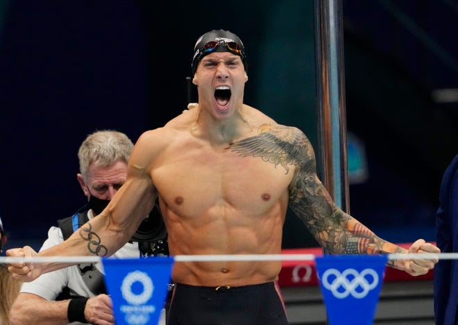 Caeleb Dressel (USA) celebrates after winning the men's 4x100m medley final during the Tokyo 2020 Olympic Summer Games at Tokyo Aquatics Centre.