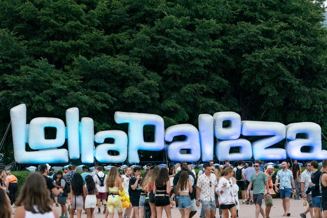 Festival-goers attend the second day of the Lollapalooza Music Festival on Friday, July 30, 2021, at Grant Park in Chicago.