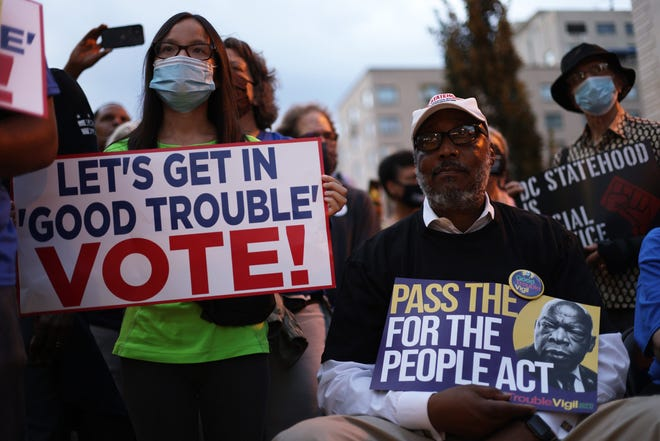"""Voting rights activists take part in a """"Good Trouble Candlelight Vigil for Democracy"""" at Black Lives Matter Plaza on July 17, 2021, in Washington, D.C. (Alex Wong/Getty Images/TNS)"""