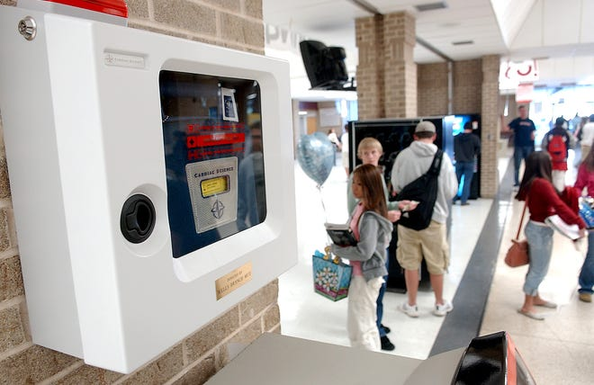 An automated external defibrillator (AED) is shown at Round Rock High School. A new law may encourage more businesses and organizations to install these life-saving devices without concern over liability.