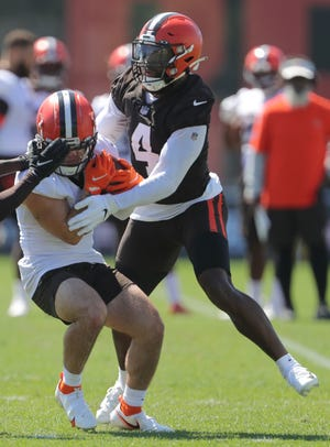 Browns linebacker Anthony Walker Jr, right, makes the hit on a receiver during practice on Monday, August 2, 2021 in Berea, Ohio, at CrossCountry Mortgage Campus. [Phil Masturzo/ Beacon Journal]