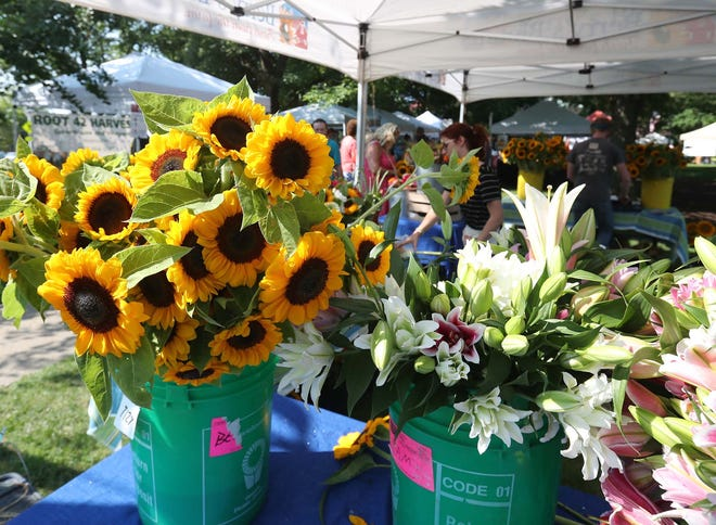 Flowers are for sale from vendor Berry's Blooms at the Medina Square Farmers Market.