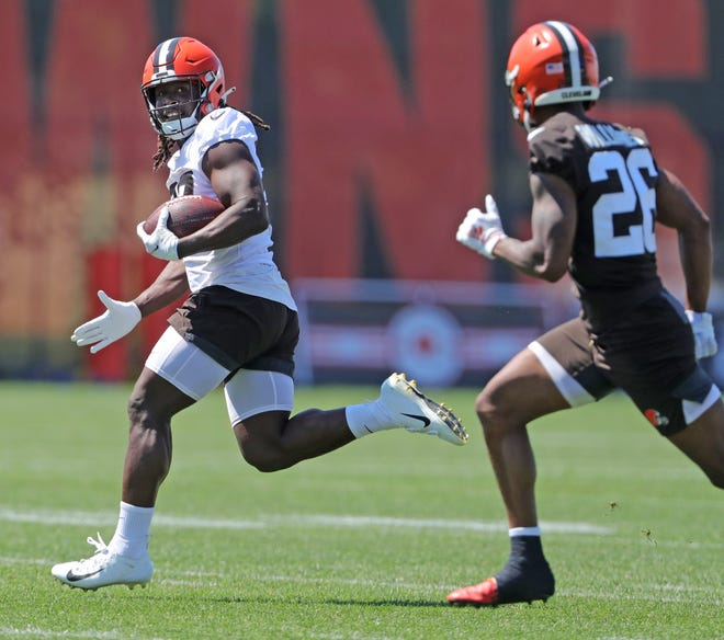 Browns running back Kareem Hunt gets away from defensive back Greedy Williams during a practice on Monday. Hunt said he is happy that running back Nick Chubb signed a new contract that will keep the two together for at least the next two seasons. [Phil Masturzo/ Beacon Journal]
