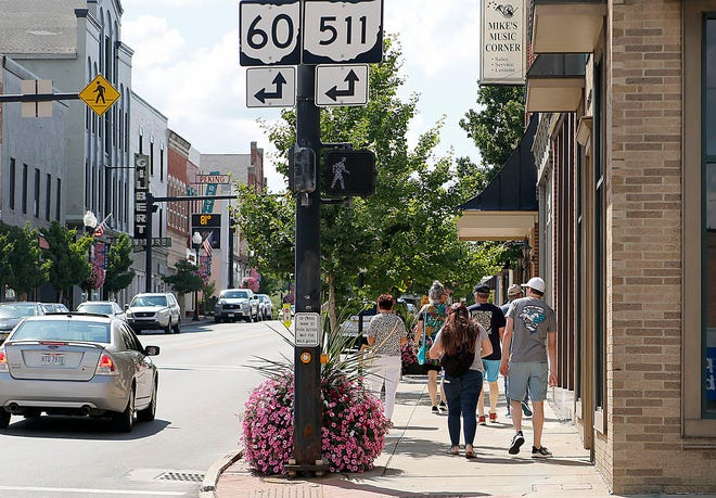 A group of people are seen walking on E. Main Street near the intersection of Center Street on Monday, Aug. 2, 2021. TOM E. PUSKAR/TIMES-GAZETTE.COM