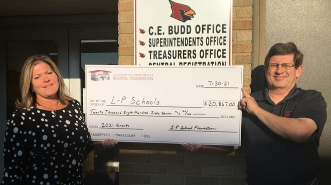 Loudonville-Perrysville Superintendent Catherine Puster receives a grant of $20,867 to the Loudonville-Perrysville School Foundation.