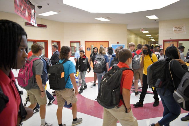 Screven County High School students walk through the commons area toward other halls as they change classes Monday morning on the first day of the 2021-2022 school year. The entire school system is taking in-person classes this year.