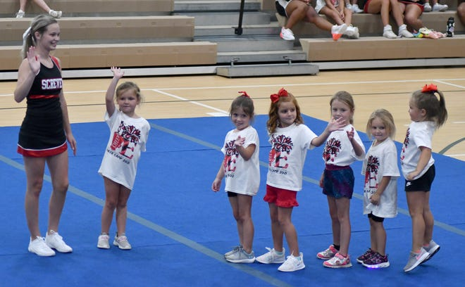 With SCHS sophomore Jada Kate Monroe leading the group, the youngest cheer camp participants wave to family and friends in the audience in the county recreation department gymnasium. Fellow cheerleader Gisell Gomez also worked with the girls group.