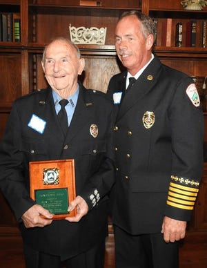 Roy Wingler, at left, if pictured with current Hampton County Fire Chief Greg Cook as he received the Home Town Hero Award in 2017.
