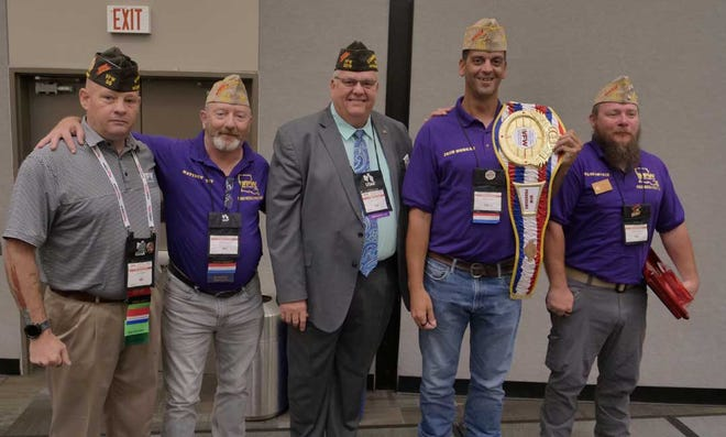 VFW National Commander Hal Roesch (center) and VFW Programs Director Lynn Rolf (left), present the 2021 Fred C. Hall Memorial Outstanding Post Special Programs Award to VFW Post 3619 Commander Joshua Morgan (second from left). Also pictured are past VFW Department of Louisiana Commander Matt West (second from left) and VFW Post 3619 Quartermaster Shane Fowler.