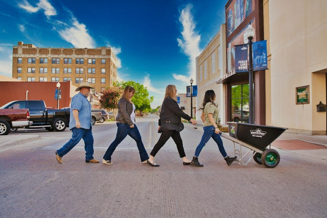 From left, KBB board members Mike Roy, Bailey Blair, Sunni Gifford-Modawell and Julia Rodriguez-Arreola walk across Center Avenue in an Abby Road-style photo shoot.
