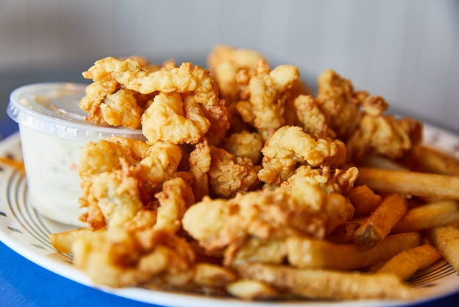 Seafood Sam's Fried Whole Belly Clam Platter comes served with cole slaw and fries. The restaurant has been sourcing their clams from the Kneeland family for 50 years.