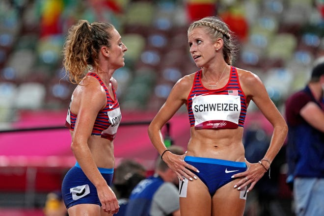 United States' Karissa Schweizer, right, and Elise Cranny talk during the Tokyo 2020 Olympic Summer Games.