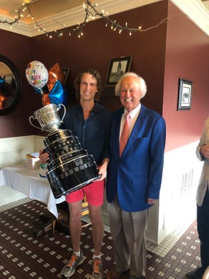 For the seventh time in 31 years as majority owner of a minor league professional hockey franchise, Chillicothean and local businessman Steve Franke celebrated his team's capture of a league championship for a seventh time last month. The Fort Wayne (Ind.) Komets, reaching the ECHL (founded as the East Coach Hockey League in 1988-89) championship series for the first time in their nine seasons in the league, captured the loop's title trophy – the Kelly Cup – three games to one over the South Carolina Stingrays. The July 2 clincher at Fort Wayne's Memorial Coliseum came by While it was the first ECHL crown for the franchise of which team chairman/CEO Franke – owner of Chillicothe's MidWest Quality Gloves, Inc./MidWest Gloves and Gear, his three brothers, and, now, son Stephan (seen holding the Kelly Cup with his father at a family celebration) share ownership, it was preceded by a half-dozen other league titles during the organization's existence in various pro hockey minor leagues (Central, United, and International) during the Franke family's ownership tenure. Because of the delayed start to the past season, as a result of the COVID-19 pandemic, chairman Franke noted it was the first time the franchise had played games during June or July. The Komets won the first game of the best-of-5 series on the road, then swept games three and four on home ice to close out the series and earn the title. To reach the league finals, they had defeated the Allen Americans in the ECHL's Western Conference finals after barely surviving a first-round series against Wichita (Kan.) with a 4-3 overtime victory on home ice in the fifth and deciding game. ( PHOTO SUPPLIED / STEVE FRANKE )