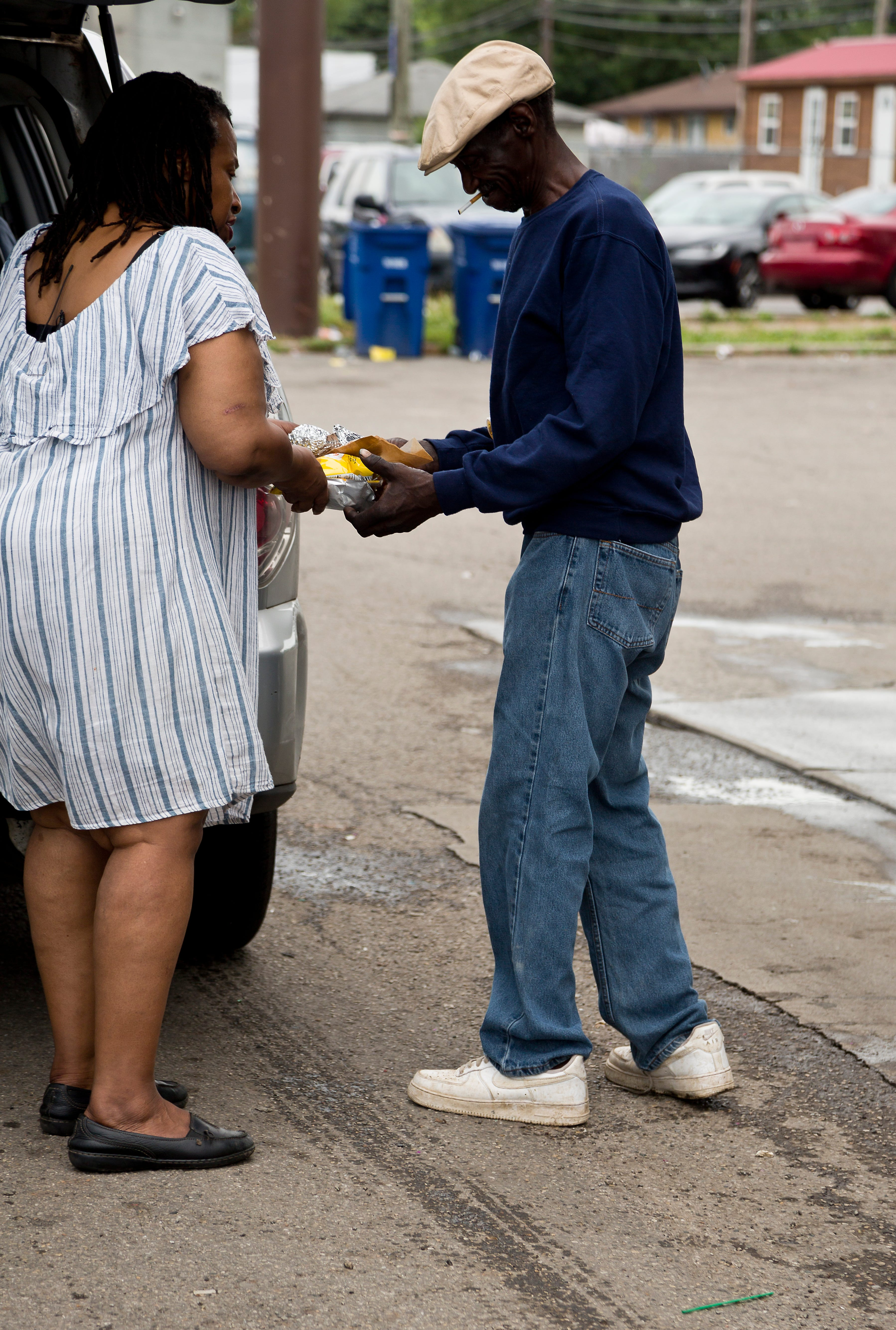 Everyday Hero finalist Debra McCauley hands out food to members of Columbus's homeless population on Thursday, July 1, 2021.