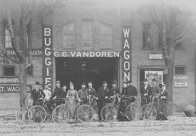 Members of the Adrian Bicycle Club pose in front of C.C. VanDoren's store at 135 S. Winter St. in Adrian, just before heading out on one of their regular rides in the late 1890s. As with the modern bicycle, the ladies' model had the cutaway frame enabling them to be ridden while wearing a skirt.
