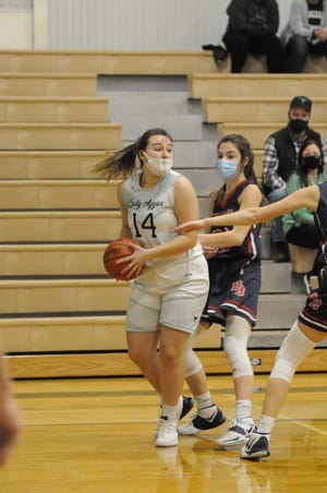 Sand Creek's Kindell Covey (14) moves with the ball during a game against Britton Deerfield on March 4.