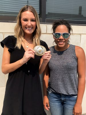 Alesha Pedigo and Andrea Jones were the finders of the 2021 Dodge City Days Medallion which was returned on Monday.