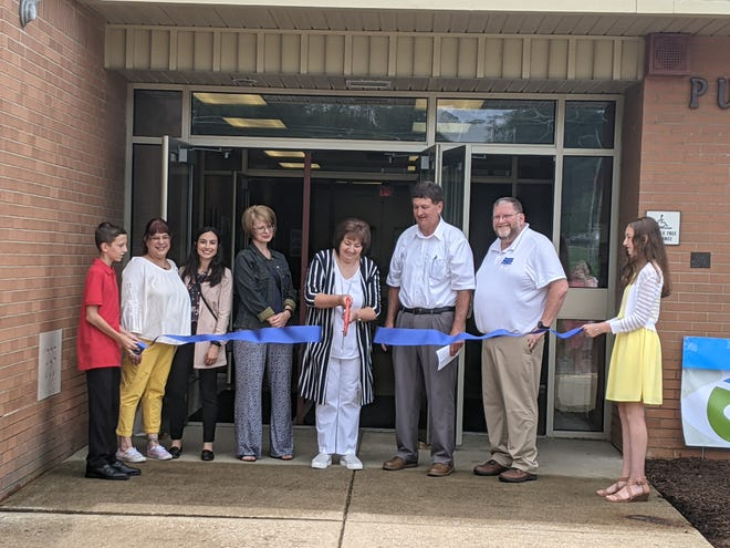 The River Valley Community Resource Center recently opened in Pulaski Township. Pictured, from left to right, are Sam Goodge; Dana McQuiston – district director for State Rep. Chris Sainato (D-9), Ginny Jacob – assistant director for Visit Lawrence County; Kimberly Koller-Jones – executive director/CEO of the Hoyt Center of the Arts who painted a mural inside the center; center co-owners Zenia and Joseph Goodge; Alex McCoy – CEO of Lawrence County Regional Chamber of Commerce; and Marcy Goodge.
