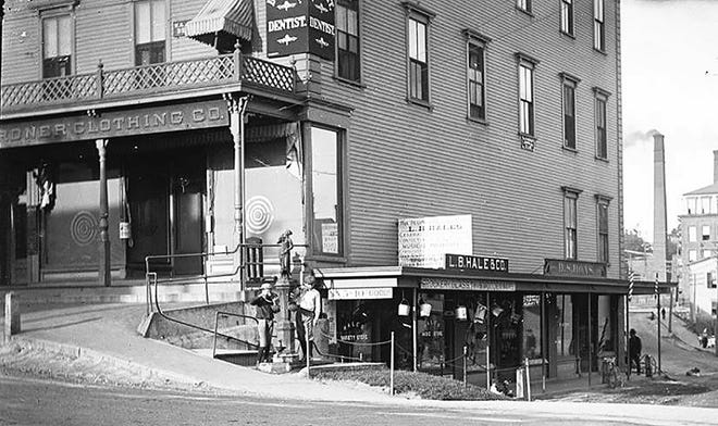 One of the first barbershops on West Lynde Street in Gardner can be spotted (far right) with the two slim barber poles hanging off the facade of the building.