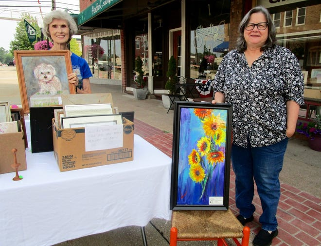 Sharon Michaelsen, left; and Mary Copersmet show some of the art work that was offered for sale at RutabagA Studio & Gallery during Geneseo's Sidewalk Sales on July 30-31