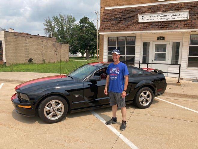 Derrick Stropes is shown by his 2005 Mustang GT which will be included in the 18th Annual Cambridge Rotary Car Show on Saturday, Aug. 14, in downtown Cambridge.