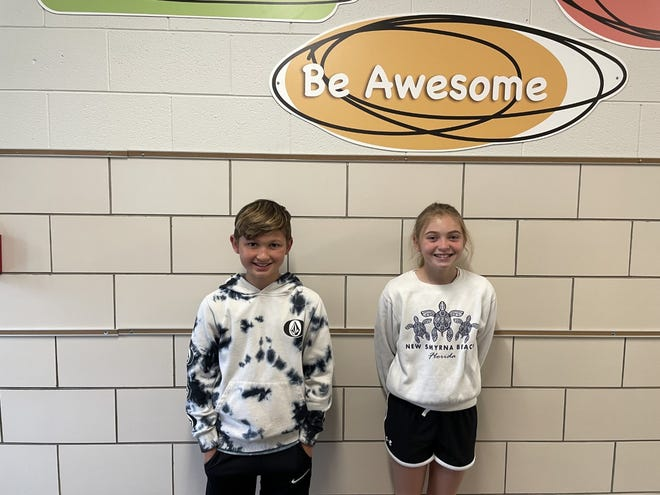"""Northside School fifth graders Kade Heilman, left; and Brooklyn Eaton, wrote the winning essays in the school's """"Penny Wars"""" competition."""