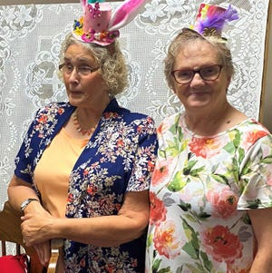 Pictured are church members Ann Anderson, left and Sharon Bainbridge, right in their hats.