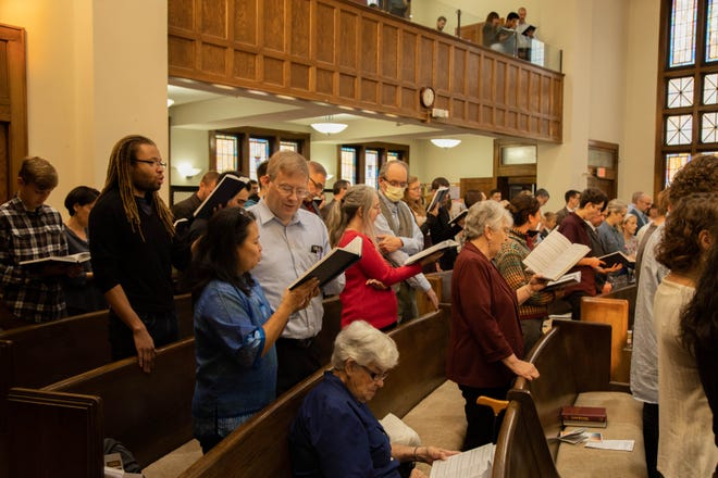 Members of the Bloomington Reformed Presbyterian Church sing together.