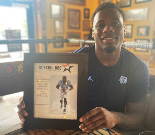 Former Northside High football standout Ja'Qurious Conley recently held a meet and greet at Mission BBQ in Jacksonville. Conley said he is excited for his second season at North Carolina.