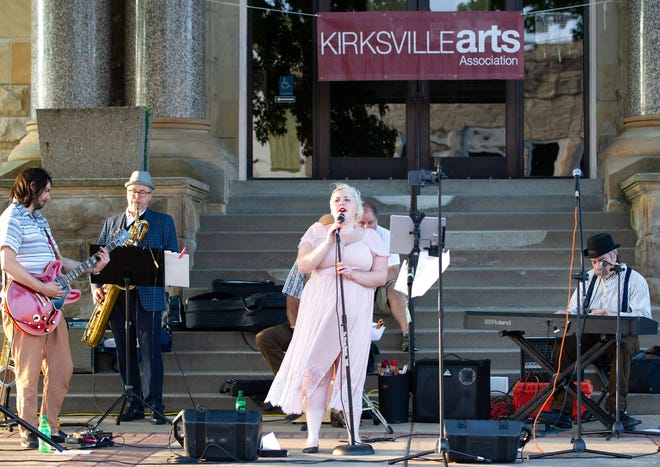 The Ragged Blade Band performs in front of the Adair County Courthouse on July 30 as part of the Summer on the Square Concert Series.