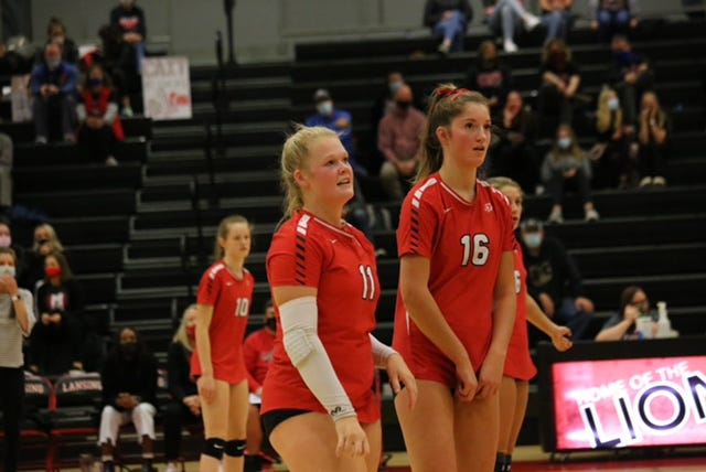 Shown from right are Lansing seniors Caitlin Bishop and Olivia Mae Van Der Werff.