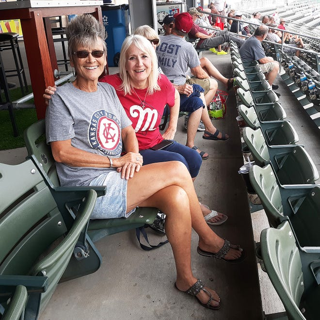 About 20 players on the Kansas City Monarchs baseball team are living with host families this summer. Cathy Stueckemann, left, and Cheryl Reitmeyer and their families are among many other families serving as hosts this summer.