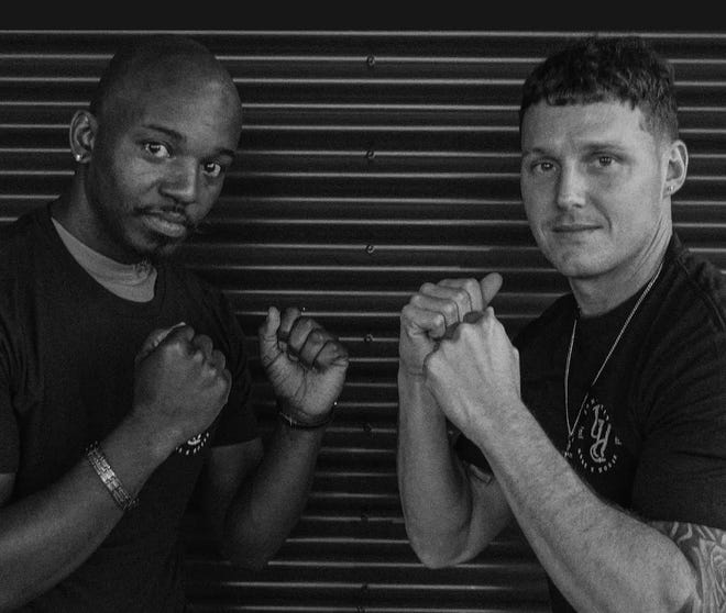 Albert Prescott (right) is a correctional officer at the United States Penitentiary in Leavenworth and will face Kansas City firefighter Larkin Collins Sr. (left) at the Guns N Hoses charity boxing event Saturday at Municipal Auditorium in Kansas City.