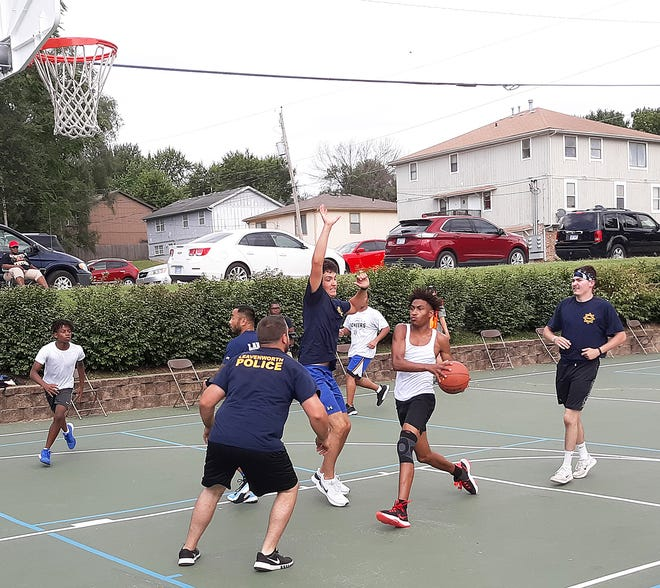 A member of the youth team drives to the basket in a basketball game on Unity Day on Saturday at Bob Dougherty Park in Leavenworth.