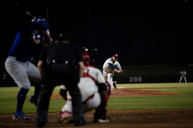 Shown is Brock Gilliam pitching for the Kansas City Monarchs.