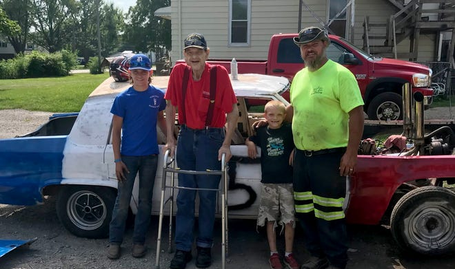 Members of the Sivil family – (left to right) Joey, Big Jim, Danny (8) and Jim – pose in front of Joey's car for tonight's Monroe County Fair Demolition Derby. Joey, 14, was given a special waiver to compete in the 6 p.m. show against his father, Jim, as a tribute to Big Jim, who is battling cancer.