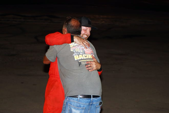 Landon Schuster of Lambertville is congratulated after his win by his dad Mark, who is his crew chief and biggest supporter after a win at Flat Rock Speedway Saturday.