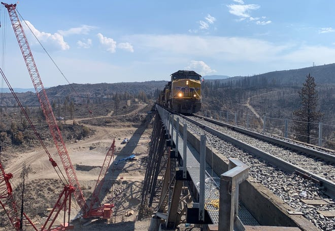 The first Union Pacific train going over the Dry Canyon bridge, north of Weed, on Aug. 1, 2021, after it was damaged by the Lava Fire on June 28.