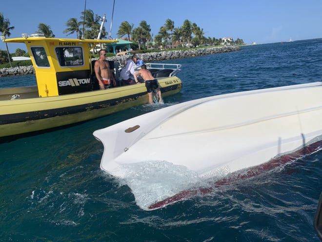 A commercial salvage boat crew rescues a boater from the water after a vessel overturned near Lake Worth Inlet on Sunday, Aug. 1, 2021. A U.S. Coast Guard Station Lake Worth Inlet boat crew, a commercial salvage boat crew and good Samaritans rescued nine people after their vessel overturned.
