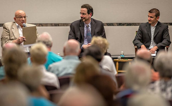 """The Palm Beach Post hosted a """"Straight from the Source"""" panel discussion on the topic of condo executive board issues in 2013. Left to right: David Israel, president of United Civic Organization at Century Village, Mark Friedman, Esq., and Anthony Marotta, President of Allied Property Management Group speak to the dozens of the event's attendees."""