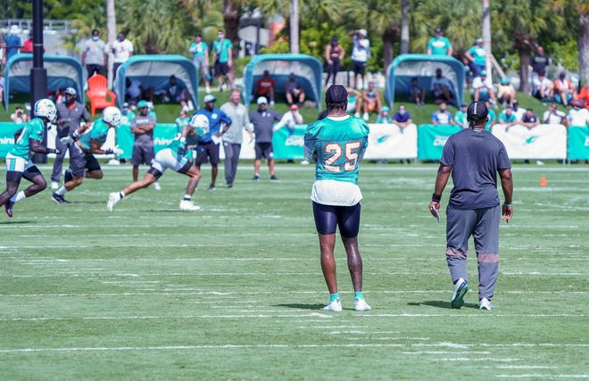 Cornerback Xavien Howard watches the team practice at Miami Dolphins training camp, July 31, 2021.