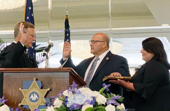 Supreme Court Justice Scott Crichton swears in Sheriff Brett Stassi as President of the La. Sheriff's Association (LSA) Board of Directors during its annual convention on July 27. Shown holding the Bible is Sheriff Stassi's wife, Caroline.